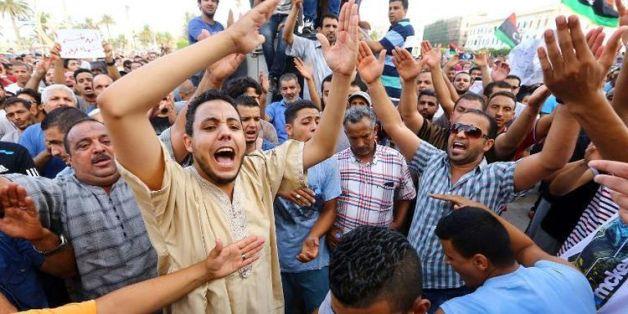 Manifestation à Tripoli le 31 juillet 2014 de Libyens réclamant une intervention de la communauté internationale pour assurer la protection des civils en Libye. (AFP)