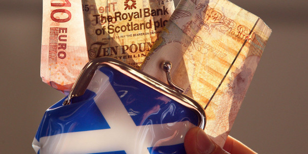 """A posed photo of an Euro, a Royal Bank of Scotland and a Bank of England note being pulled from a Saltire purse in Edinburgh, Scotland. Scotland's First Minister Alex Salmond said today that he was ready to meet Prime Minister David Cameron """"in Edinburgh, in London or wherever"""" to discuss the way forward for a referendum on independence."""