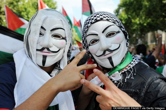 protesters wearing anonymous masks
