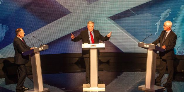 Scotland's First Minister Alex Salmond, broadcast journalist Bernard Ponsonby, and former chancellor, the leader of the pro-UK Better Together campaign Alistair Darling at a TV debate of the independence referendum campaign in Glasgow