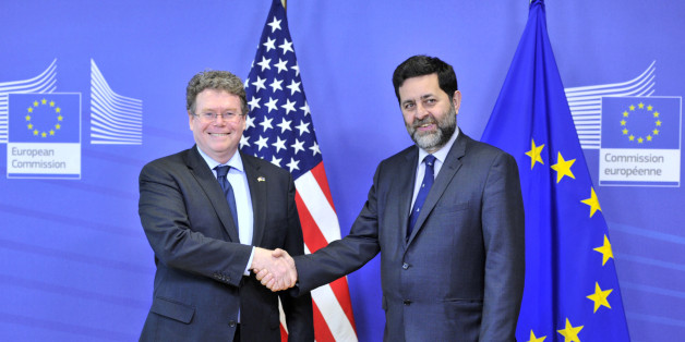 EU chief negotiator Ignacio Garcia Bercero (R) and US chief negotiator Dan Mullaney (L) pose on March 10,2014 at the EU Headquarters in Brussels. A fourth round of EU-US trade talks will kick off in Brussels to day. The talks will help pave the way for a future trade and investment deal, known as the Transatlantic Trade and Investment Partnership, or TTIP. Negotiators will discuss different aspects of the agreement, including trade in services, public procurement, rules of origin, technical barr