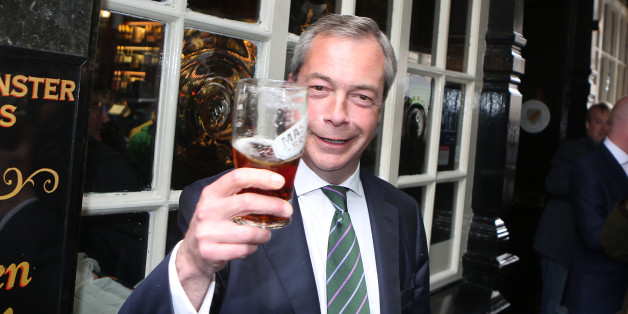 Ukip leader Nigel Farage has a pint in the Westminster Arms, London, as he celebrates his partyÕs results in the polls for the European Parliament.