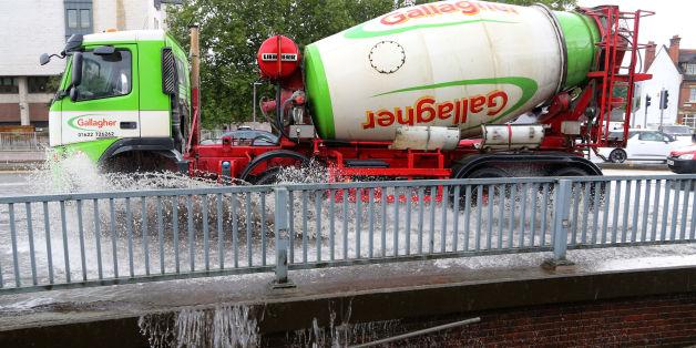 A lorry passes through a flash flood following a heavy rain shower in Maidstone, Kent.