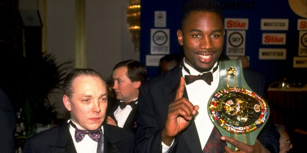 1992:   Heavyweight boxer Lennox Lewis of Great Britain shows off his WBC belt with his manager Frank Maloney. \ Mandatory Credit: Gray  Mortimore/Allsport