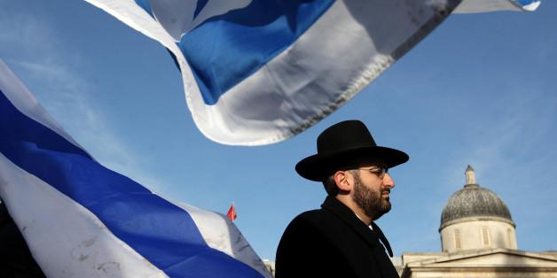 A pro-Israeli demonstrator takes part in a pro-Israeli rally in Trafalgar Square, London.