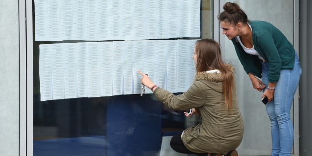 Molly Taylor (left) and Yasmin Clews check their A-level results at Worcester Sixth Form College, as official figures show that more A-levels were handed the very highest grade this summer, but the overall pass rate fell for the first time in more than 30 years.