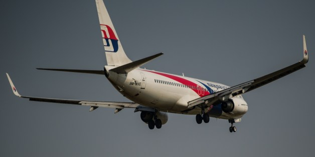 A Malaysia Airlines plane prepares for landing at the Kuala Lumpur International Airport in Sepang