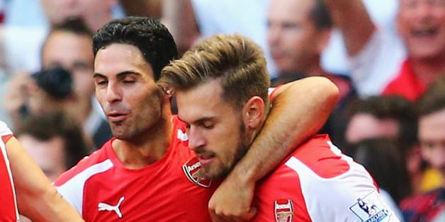 LONDON, ENGLAND - AUGUST 16: Aaron Ramsey (R) of Arsenal celebrates his goal with team mate Mikel Arteta during the Barclays Premier League match between Arsenal and Crystal Palace at Emirates Stadium on August 16, 2014 in London, England.  (Photo by Clive Mason/Getty Images)