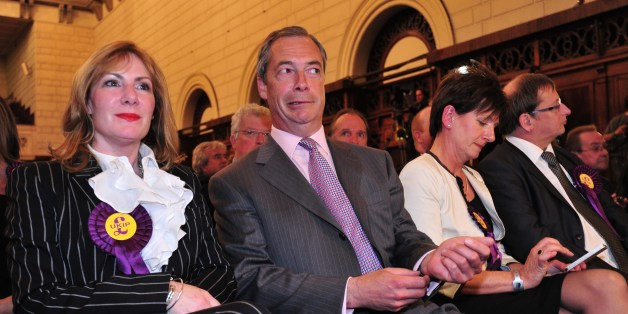 UK Independence Party (UKIP) leader Nigel Farage (2L) sits with fellow UKIP candidates Janice Atkinson (L), Diane James (2R) and Ray Finch (R) as the South East England region results of the European Parliament elections are declared by the returning officer at Southampton Guildhall in Southampton, southern England, on May 25, 2014. Results rolled in for the European Parliament elections with all eyes on potential gains by Europe's increasingly popular anti-EU parties. Farage, leader of the euro