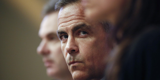 Mark Carney, governor of the Bank of England, center, pauses during the bank's quarterly inflation report news conference in London, U.K., on Wednesday, Aug. 13, 2014. Carney pledged that Bank of England officials won't rush to raise interest rates as he highlighted overseas risks to Britain's recovery and the weakness of wages. Photographer: Simon Dawson/Bloomberg via Getty Images