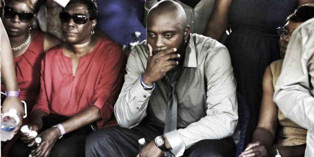 Michael Brown's Parents Attend Emotional Burial Service
