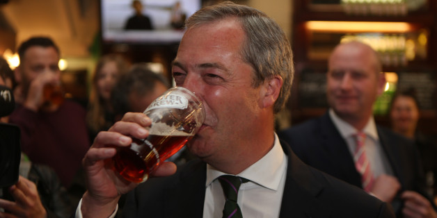 Ukip leader Nigel Farage has a pint in the Westminster Arms, London, as he celebrates his partys results in the polls for the European Parliament.