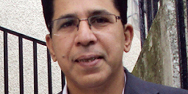 handout photo issued by Metropolitan Police of Dr Imran Farooq
