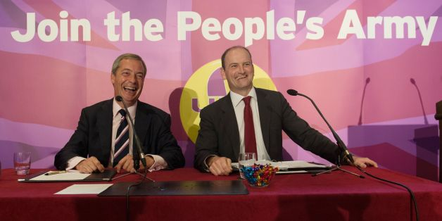 UKIP leader Nigel Farage (left) with Douglas Carswell during a press conference in central London where the Conservative MP defected to his party today.