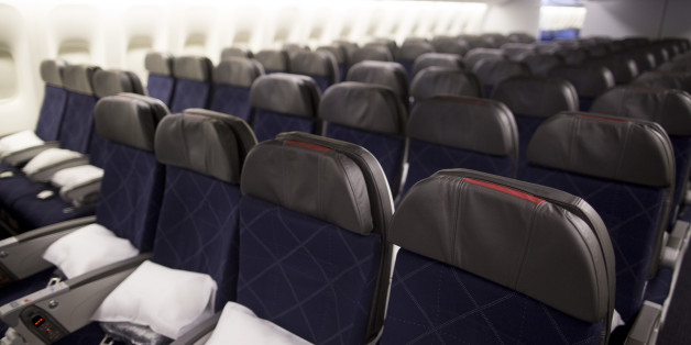 Seats in the economy class cabin on board an American Airlines plane. A flight from Miami-to-Paris has been forced to divert to Boston after a violent outburst over a reclined seat