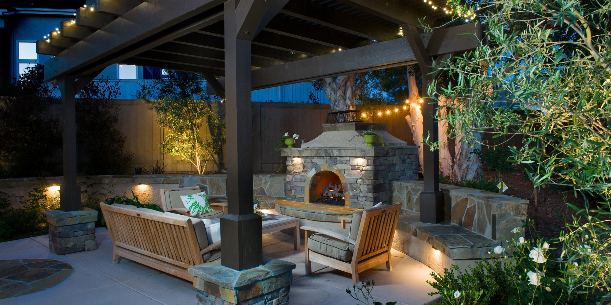 an outdoor fireplace is all you need to keep summer going huffpost