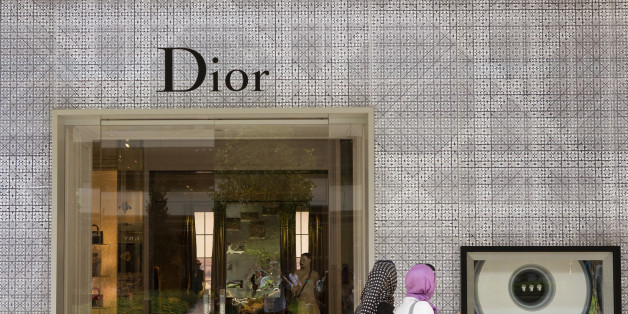 Pedestrians pass the entrance and display window of a Dior luxury fashion store, operated by Christian Dior SA, in the Zorlu shopping mall in Istanbul, Turkey