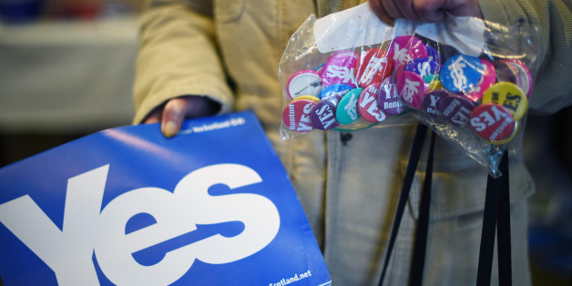 ALEXANDRIA, SCOTLAND - AUGUST 28:  An elderly woman holds a bag of badges in a Yes campaign shop on August 28, 2014 in Alexandria, Scotland. In less than a month voters will go to the polls to vote yes or no on whether Scotland should become an independent country.  (Photo by Jeff J Mitchell/Getty Images)