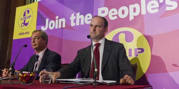 Former British Conservative Party MP Douglas Carswell (R) addresses a press conference in central London on August 28, 2014, with UKIP Party leader Nigel Farage (L). British MP Douglas Carswell dealt a heavy blow to Prime Minister David Cameron on Thursday as he announced he was to leave the Conservative Party and join the UK Independence Party (UKIP).  AFP PHOTO / JUSTIN TALLIS        (Photo credit should read JUSTIN TALLIS/AFP/Getty Images)