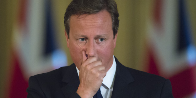 Prime Minister David Cameron pauses during a news conference in Downing Street, central London.
