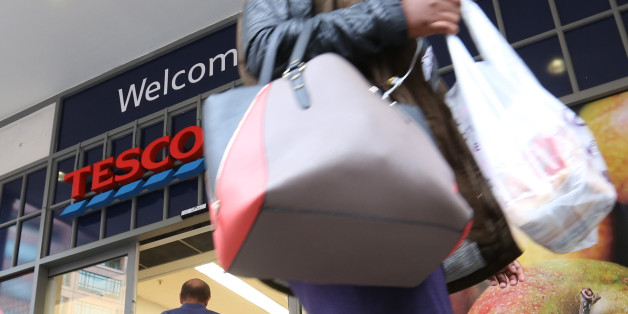 A customer leaves a Tesco Metro supermarket store, operated by Tesco Plc, in London, U.K., on Friday, Aug. 29, 2014. Tesco Plc unexpectedly slashed its dividend and reduced investment as the largest U.K. retailer was squeezed between German discount chains and upscale stores such as Waitrose, driving the stock to the lowest in almost 11 years. Photographer: Chris Ratcliffe/Bloomberg via Getty Images