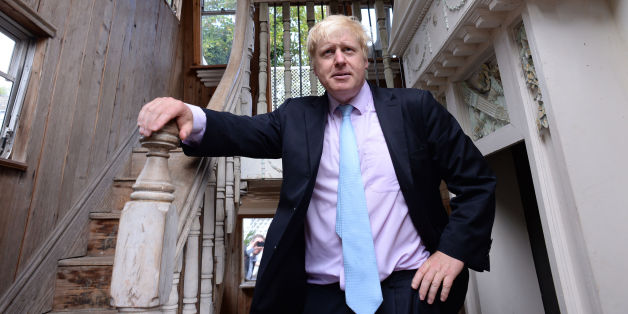 The Mayor of London Boris Johnson looks around a double decker caravan with a 'stately home' style interior during his visit to Sutton House in Hackney, north London.