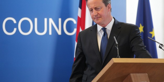 British Prime Minister David Cameron pauses before speaking during a media conference after an EU summit in Brussels on Friday, June 27, 2014. European Union leaders have nominated former Luxembourg Prime Minister Jean-Claude Juncker to become the 28-nation bloc's new chief executive. Juncker's nomination is breaking with a decades-old tradition of choosing the Commission president by consensus because Britain opposed him. (AP Photo/Yves Logghe)