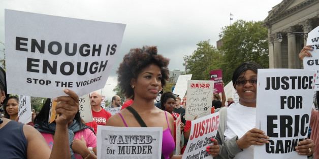 People gather to protest the killing of Eric Garner in New York on Aug. 24. Garner, 43, died on July 17 as cops tried to cuff him for allegedly selling bootleg cigarettes on a Staten Island sidewalk.