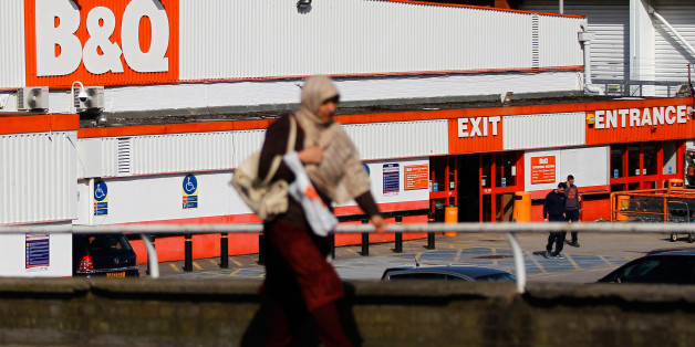 A pedestrian walks past a B&Q home improvement store, operated by Kingfisher Plc, in Manchester, U.K., on Monday, March 24, 2014. Kingfisher, the owner of the B&Q DIY chain, may announce a dividend for shareholders or share buyback option at its annual results, the Financial Times newspaper reported last week. Photographer: Paul Thomas/Bloomberg via Getty Images