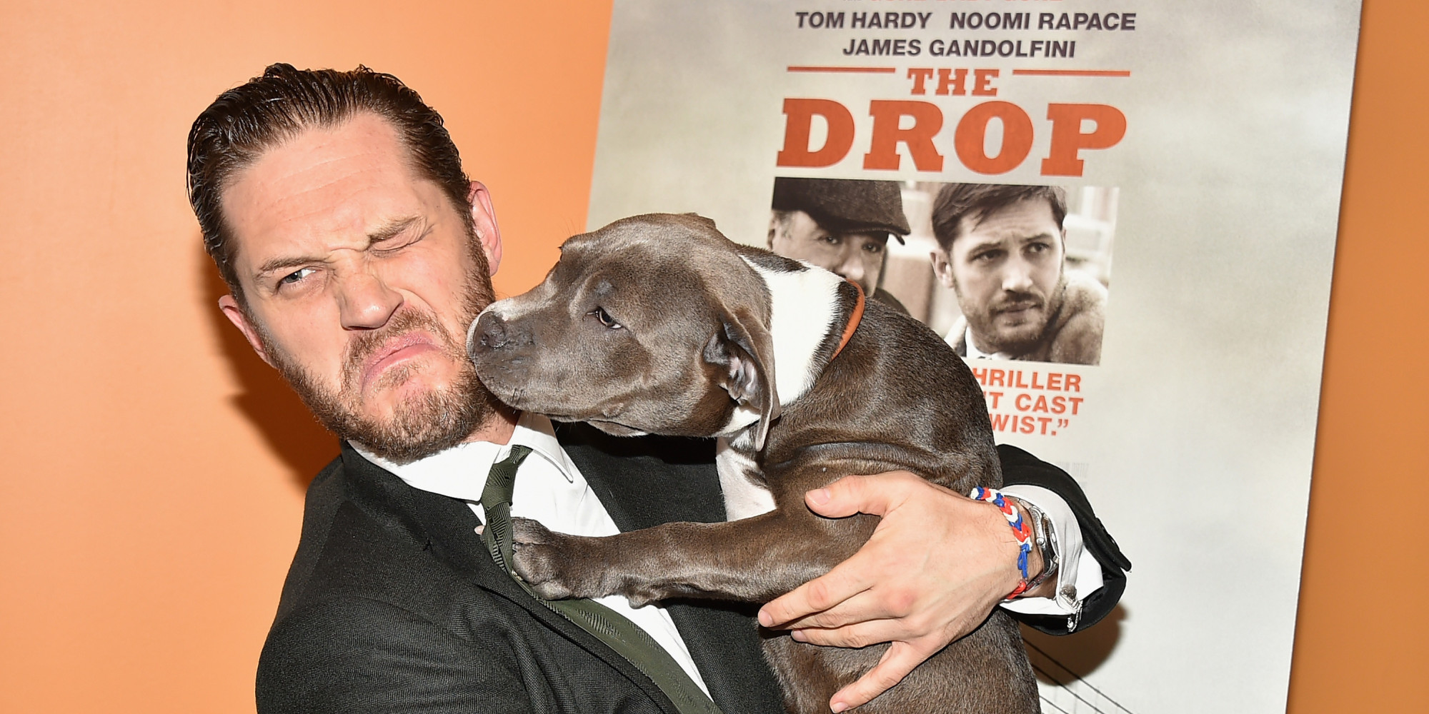 10 Pictures Of Tom Hardy Playing With A Dog At The