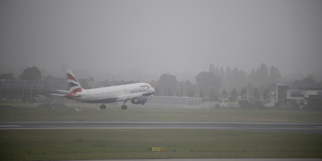 A plane lands at Heathrow Airport, west London as much of southern England has been blanketed in thick fog with flights delayed as visibility dips to less than 100 metres in places