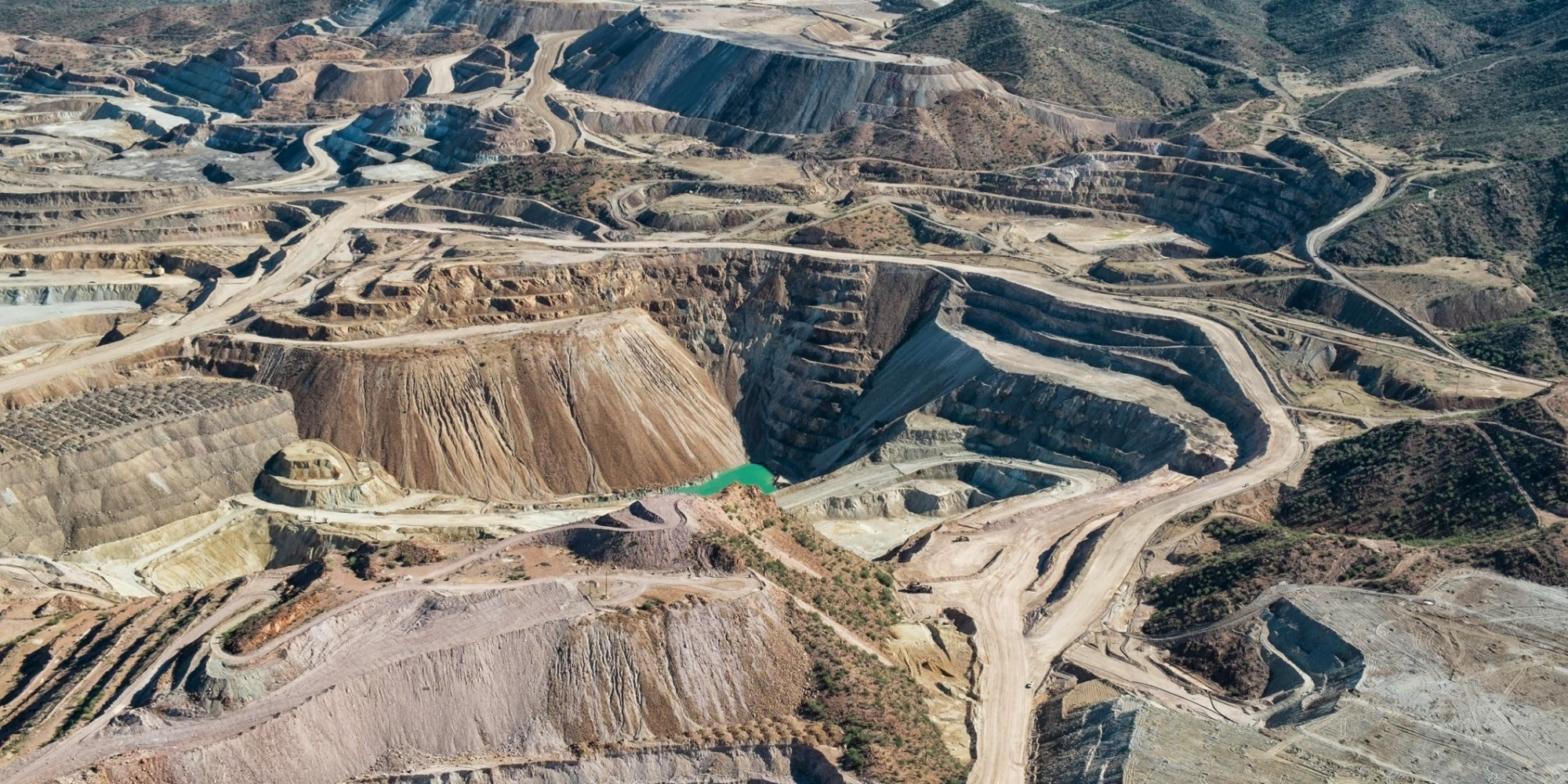 features of open pit mining Economically exploitable reserves in an open-pit mine  developed for that  study area reflect the general characteristics of the deposit and are consistent  with.