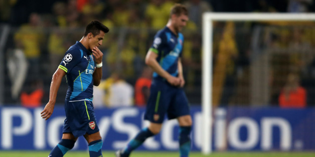 DORTMUND, GERMANY - SEPTEMBER 16:  Alexis Sanchez and Per Mertesacker of Arsenal looks dejected during the UEFA Champions League Group D match between Borussia Dortmund and Arsenal at Signal Iduna Park on September 16, 2014 in Dortmund, Germany.  (Photo by Friedemann Vogel/Bongarts/Getty Images)