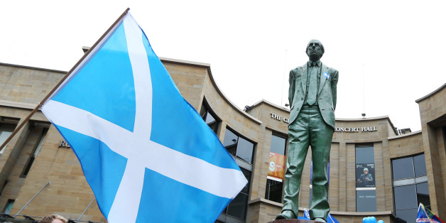 The Donald Dewar statue with a Yes sticker in Buchanan Street, Glasgow, ahead of the Scottish independence referendum that takes place tomorrow.