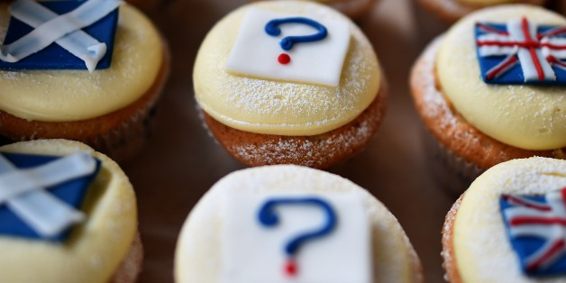 'Referendum cupcakes' featuring a Scottish Saltire, (L) a Union flag (R) and a question mark (C) symbolising the 'undecided voter' are pictured in a bakery in Edinburgh, Scotland, on September 16, 2014, ahead of the referendum on Scotland's independence. The leaders of the three main British parties on Tuesday issued a joint pledge to give the Scottish parliament more powers if voters reject independence, in a final drive to stop the United Kingdom splitting.  AFP PHOTO / BEN STANSALL        (Ph