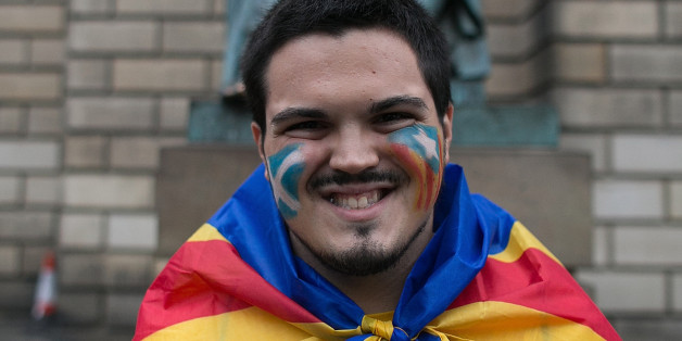 A Catalan man, is seen in the streets of Edinburgh with Catalan flag to support the 'Yes' campaign