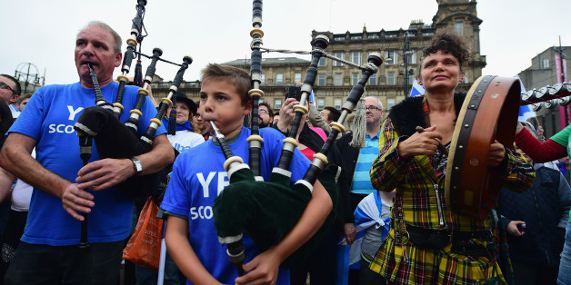 GLASGOW, SCOTLAND - SEPTEMBER 18:  Pipers play in George Square, just a few hours before polling stations will close in the Scottish independence referendum on September 18, 2014 in Glasgow, Scotland. After many months of campaigning the people of Scotland today head to the polls to decide the fate of their country. The referendum is too close to call but a Yes vote would see the break-up of the United Kingdom and Scotland would stand as an independent country for the first time since the format
