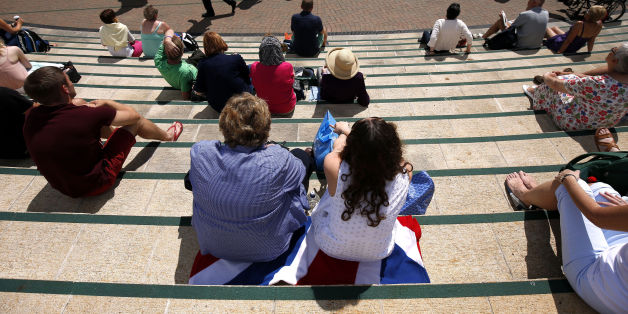 Fans on Murray mount soak up the sun during day three of the Wimbledon Championships at the All England Lawn Tennis and Croquet Club, Wimbledon.