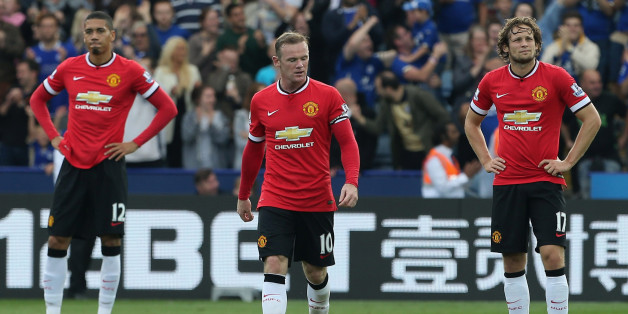 LEICESTER, ENGLAND - SEPTEMBER 21:  Chris Smalling, Adnan Januzaj and Wayne Rooney of Manchester United show their disappointment during the Barclays Premier League match between Leicester City and Manchester United at The King Power Stadium on September 21, 2014 in Leicester, England.  (Photo by John Peters/Man Utd via Getty Images)