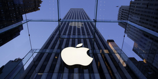 The Apple logo hangs in the glass box entrance to the company's Fifth Avenue store, Thursday, Sept. 5, 2014 in New York. (AP Photo/Mark Lennihan)