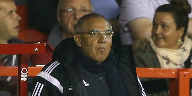 NOTTINGHAM, ENGLAND - SEPTEMBER 17:  Felix Magath, (C) the Fulham manager looks on with his management team during the Sky Bet Championship match between Nottingham Forest and Fulham at the City Ground on September 17, 2014 in Nottingham, England.  (Photo by David Rogers/Getty Images)