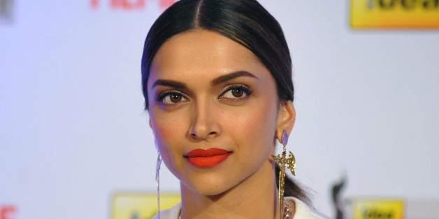 Indian Bollywood actress Deepika Padukone attends the cover launch for the 59th Idea Filmfare Awards Issue in Mumbai on February 14, 2014. AFP PHOTO/STR        (Photo credit should read STRDEL/AFP/Getty Images)