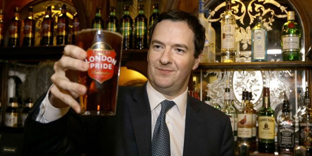 Chancellor of the Exchequer George Osborne holds a pint of beer during a visit to officially re-open The Red Lion pub, following a major refurbishment in Whitehall, central London.