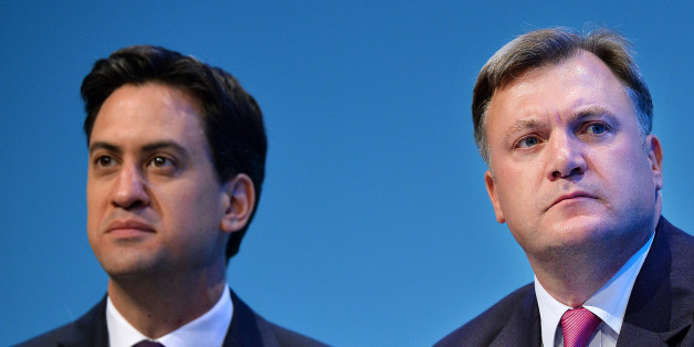 Britain's Labour party leader Ed Miliband (L) and Shadow Chancellor of the Exchequer Ed Balls attend the second day of the Labour party conference in Brighton, Sussex, south England on September 23, 2013. Britain's main opposition Labour party kicked off its annual conference on September 22 with leader Ed Miliband under pressure amid sliding poll ratings 18 months before a general election.AFP PHOTO / BEN STANSALL        (Photo credit should read BEN STANSALL/AFP/Getty Images)
