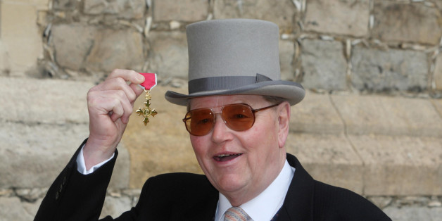 Former racehorse trainer Toby Balding poses with his medal after he was made an Officer of the Order of the British Empire (OBE) by Britain's Queen Elizabeth II during an investiture ceremony at Windsor Castle on April 3, 2012.  AFP PHOTO / POOL / STEVE PARSONS (Photo credit should read Steve Parsons/AFP/Getty Images)