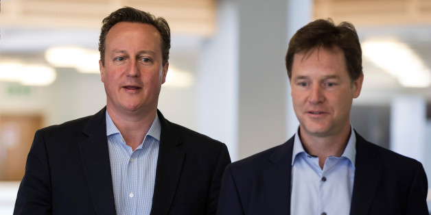 Prime Minister David Cameron (left) and Deputy Prime Minister Nick Clegg during a visit to Pentland Brands plc headquarters in north London.