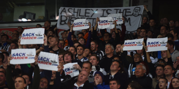 STOKE ON TRENT, ENGLAND - SEPTEMBER 29:  Newcastle fans hold up signs calling for Alan Pardew, manager of Newcastle United, to be sacked as they watch the Barclays Premier League match between Stoke City and Newcastle United at Britannia Stadium on September 29, 2014 in Stoke on Trent, England.  (Photo by Laurence Griffiths/Getty Images)