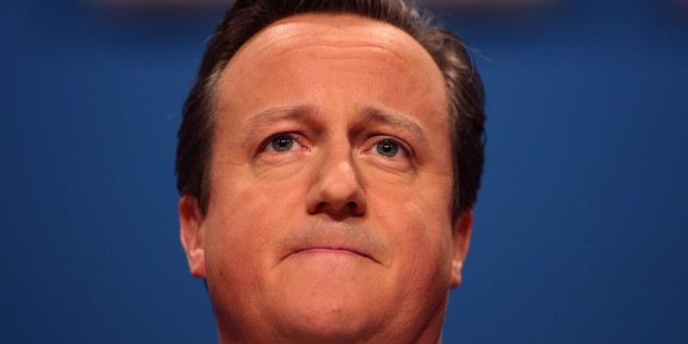 David Cameron, U.K. prime minister, pauses as he addresses delegates at the Conservative party's annual conference in Birmingham, U.K., on Wednesday, Oct. 1, 2014. Cameron pledged to cut taxes for people on middle incomes as well as the lowest paid if he wins next year's general election, taking the fight to the Labour opposition that's leading in the polls. Photographer: Chris Ratcliffe/Bloomberg via Getty Images