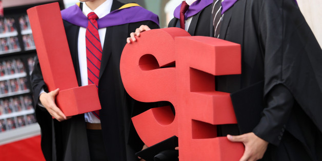 Students from the London School of Economics & Political Science (LSE) pose for a photograph with the letters reading 'LSE' during a ceremony for university graduates in London, U.K., on July 18, 2013. U.K. unemployment claims fell at their fastest pace in three years in June, adding to evidence the economic recovery is gaining momentum. Photographer: Chris Ratcliffe/Bloomberg via Getty Images