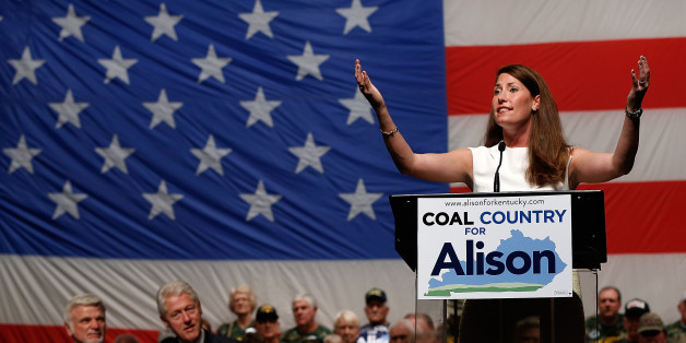 US Senate Democratic candidate and Kentucky Secretary of State Alison Lundergan Grimes speaks at a campaign event with former US President Bill Clinton on August 6, 2014